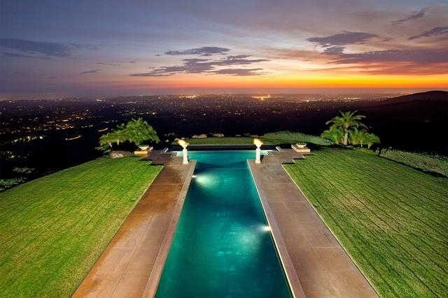 pool-view-at-night-of-the-paint-mountain-mansion